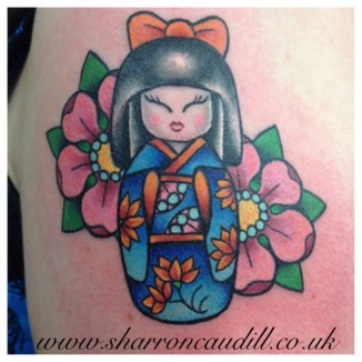 Japanese doll tattoo